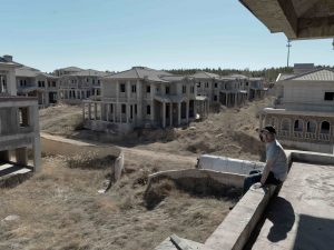 On The Other Side Of Town, Dr. John McGovern Tours An Unfinished Mansion Complex