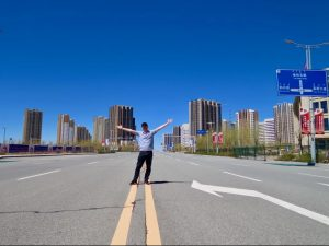 Pioneer Media's John McGovern Poses On A Deserted Highway In Ordos Ghost City